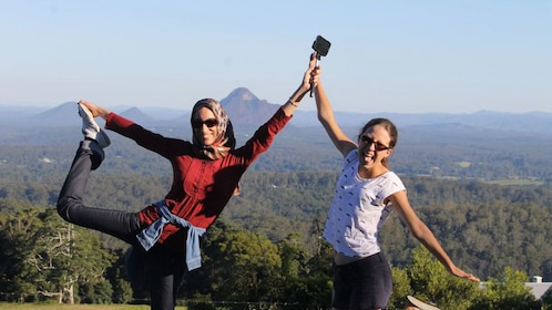 Pair of young women with a view of the mountains in the background in Brisbane