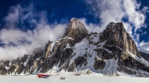 Tour group and plane on the mountains in Alaska