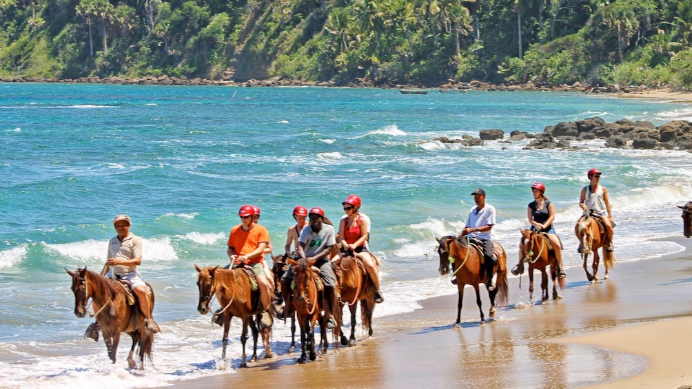 Show item 1 of 10. Horseback riding on the beach in Puerto Plata, Dominican Republic