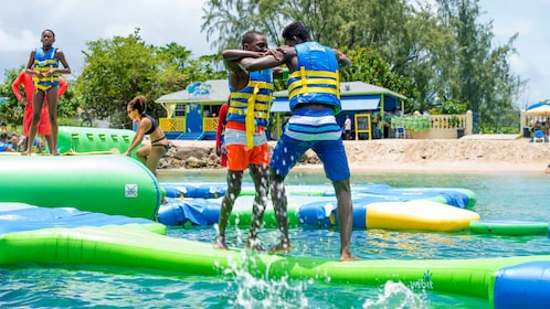 Pair of young men playing at Splash Island Water Park in St Lucia