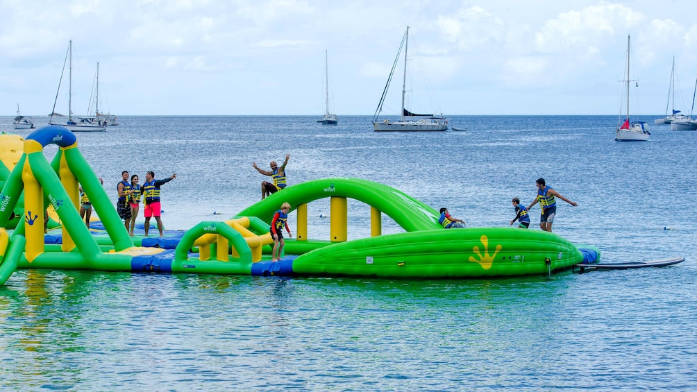 Show item 5 of 10. Floating rafts at Splash Island Water Park in St Lucia