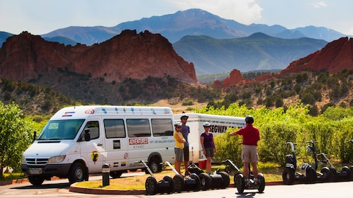 A van next to a Segway tour group in Colorado