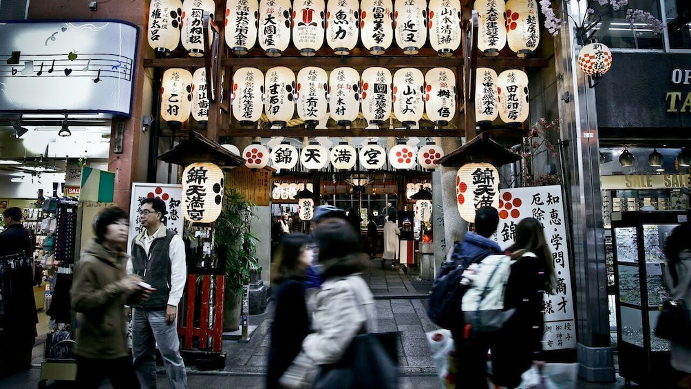 Show item 3 of 5. Lanterns on a crowded Japanese street