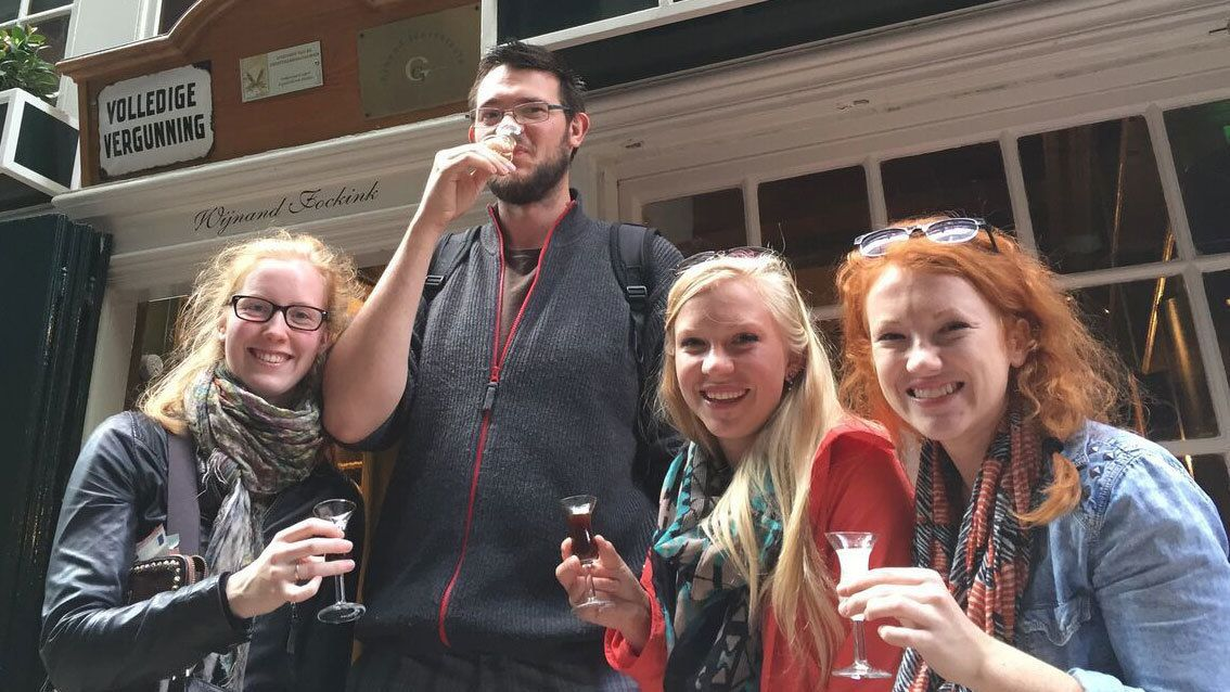 Tour group drinking small glasses of wine