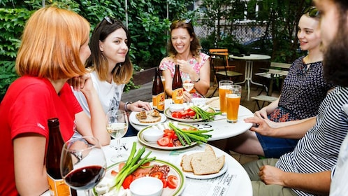 Group enjoying beer, wine and appetizers in Bucharest