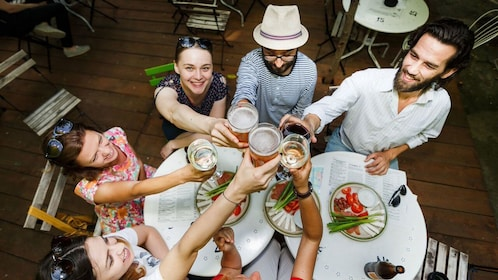 Tour group toasting at a restaurant in Bucharest