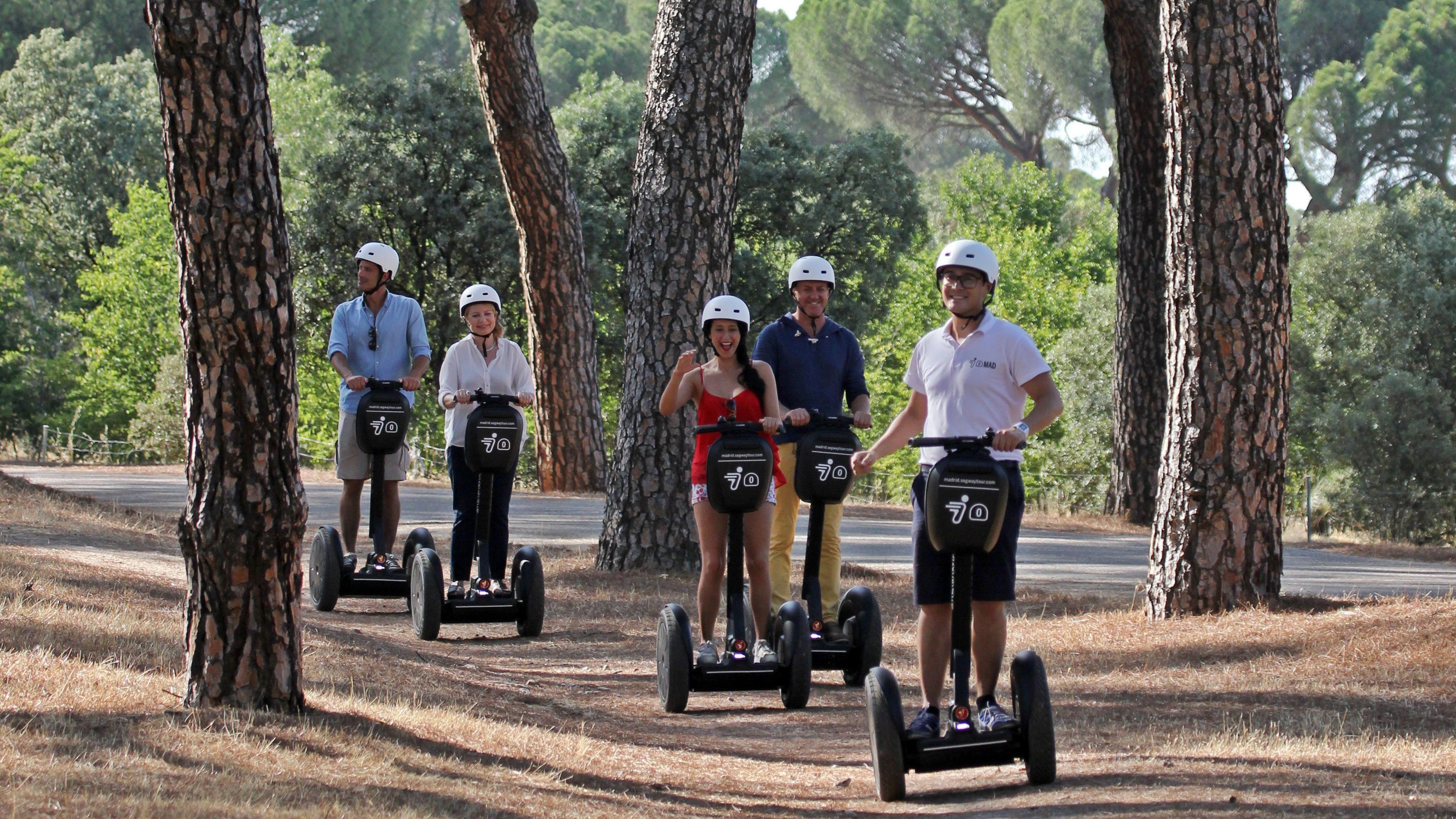 Segway group on a path through the trees in Madrid