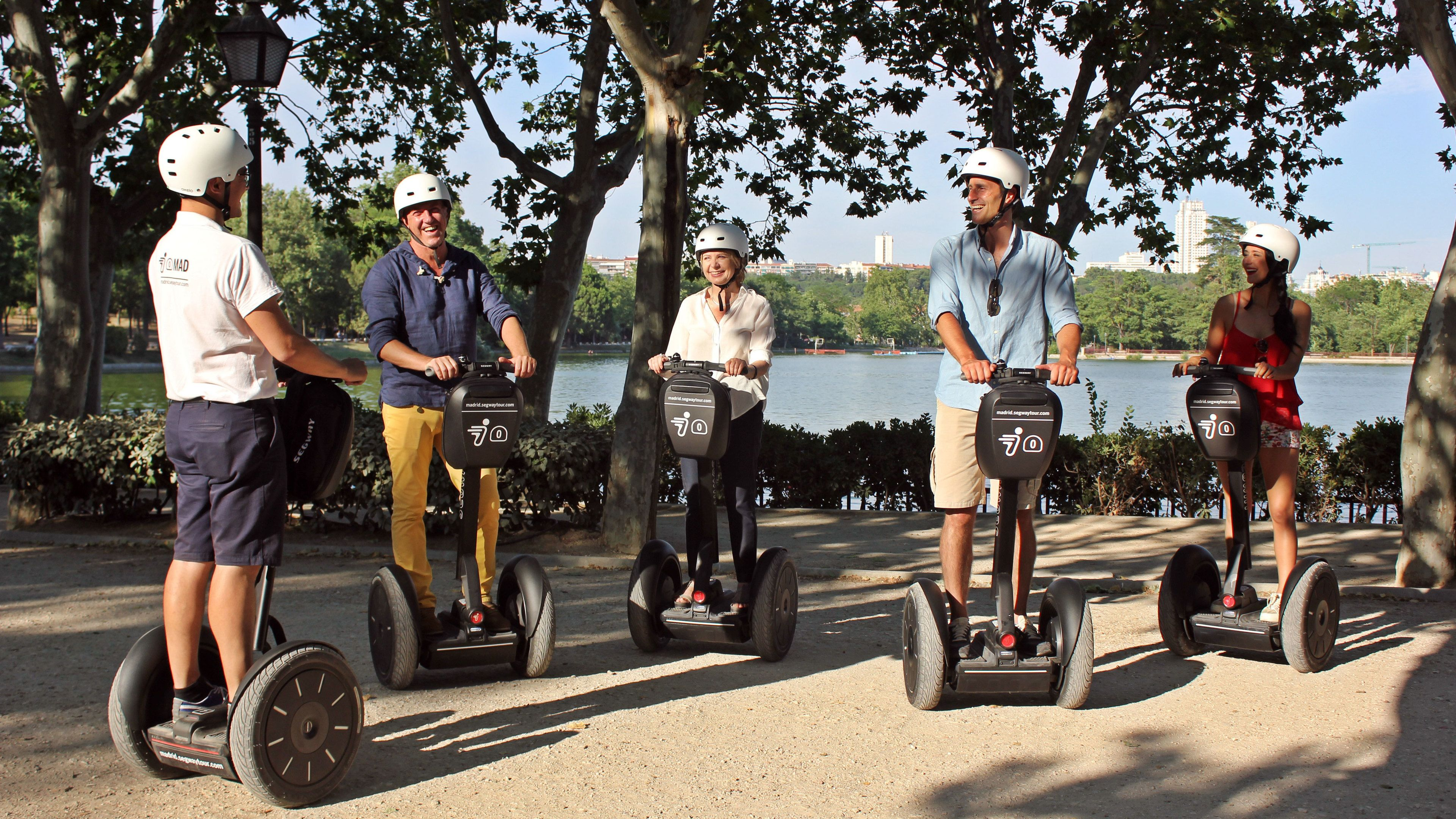 Segway group on a lakeside path in Madrid