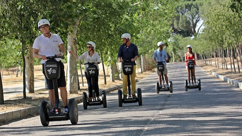 Segway group on a tree-lined road in Madrid