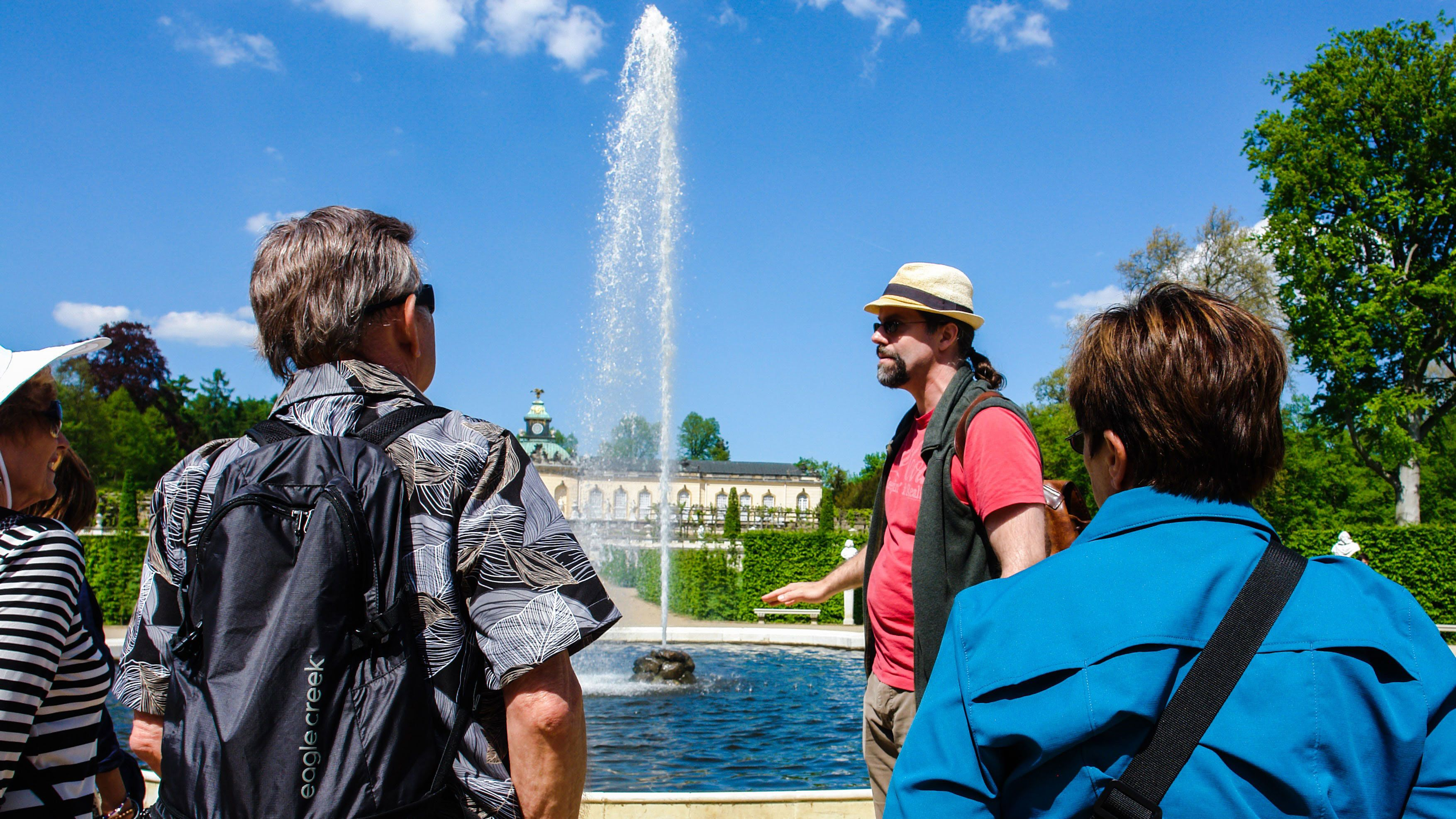 Tour guide and group at a fountain in Potsdam