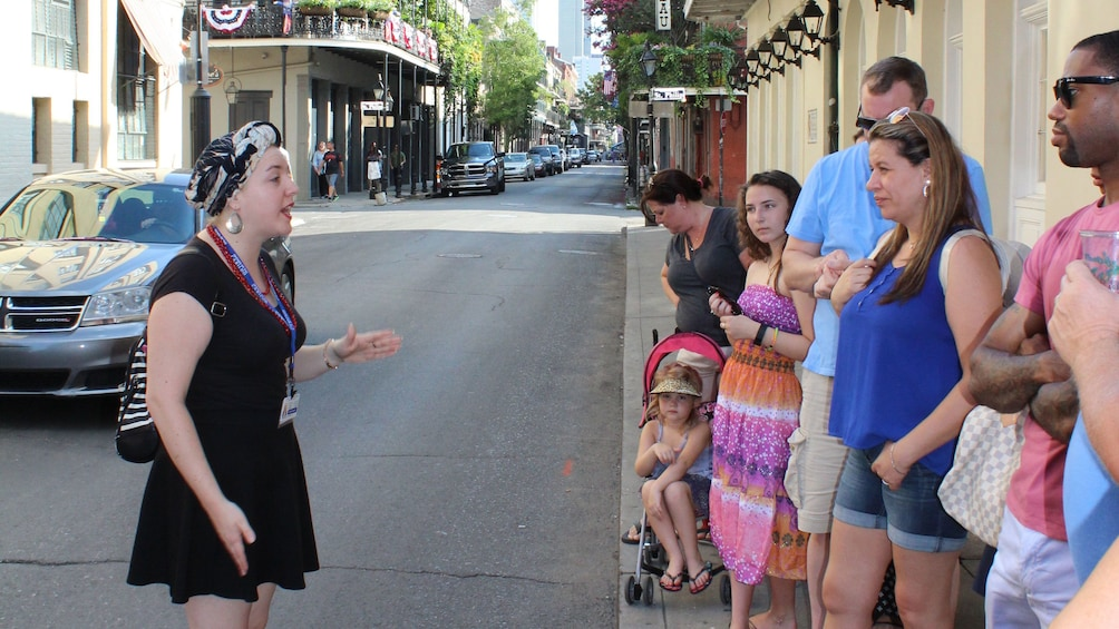 Show item 5 of 5. Tour guide talking to group on the street in New Orleans