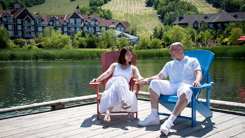 Couple on a dock on a lake in Blue Mountain
