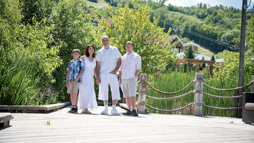Family with lush trees in the background in Blue Mountain