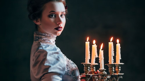 Woman holding a candelabra