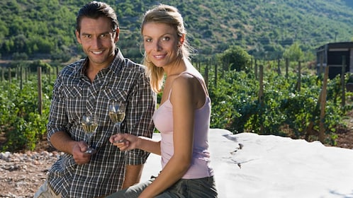 Couple enjoying wine on the Deluxe Wine Tour in Vancouver BC
