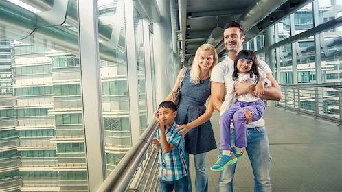 Family at the petronas twin towers in Kuala Lumpur, Malaysia
