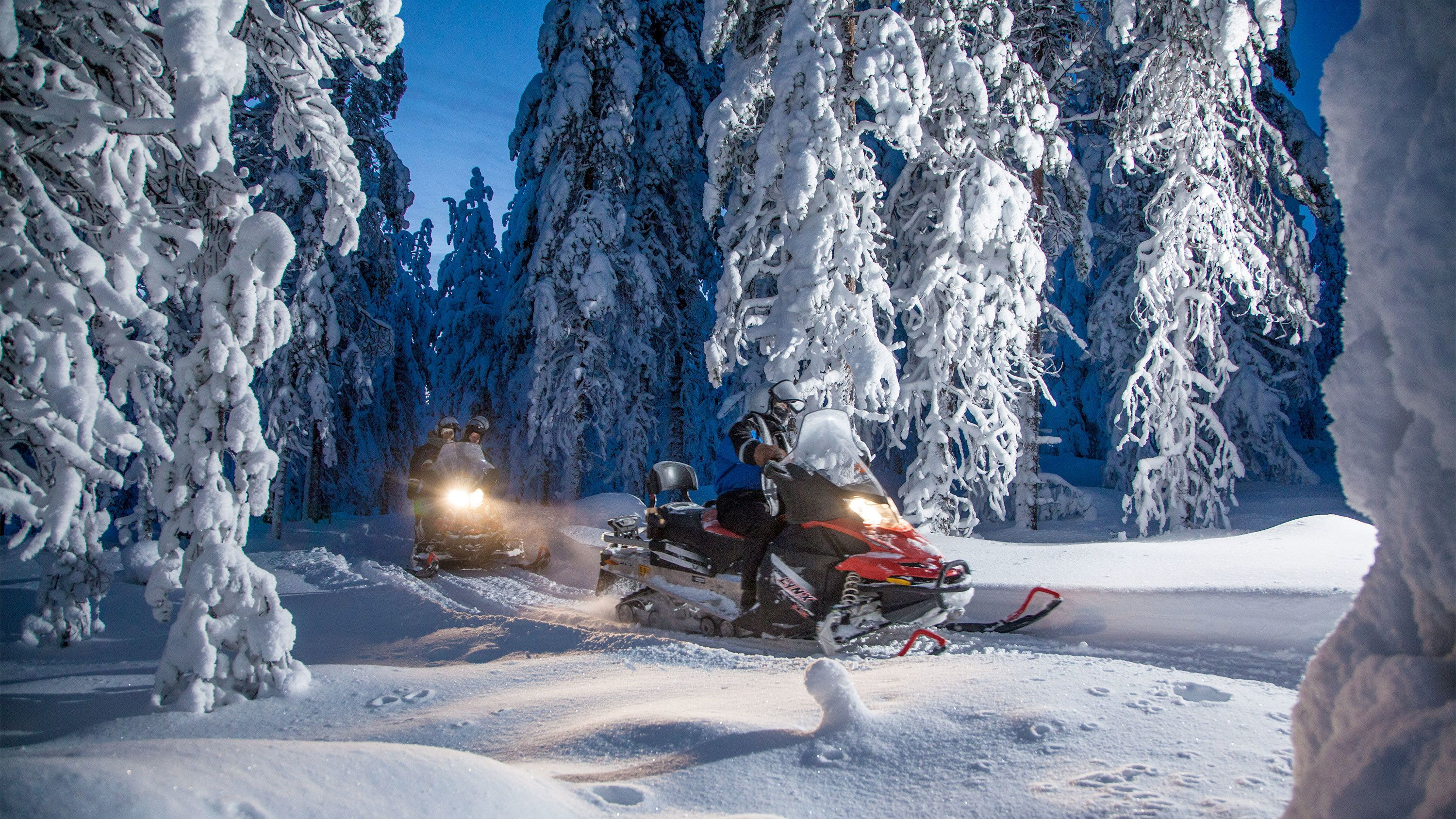 View of a group snowmobiling in Finland