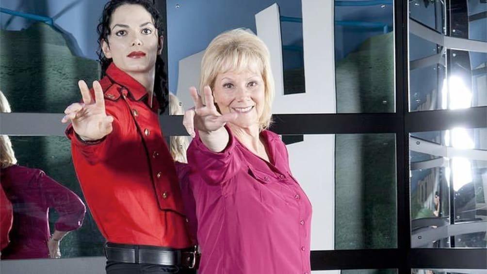 Cargar ítem 1 de 5. Woman posing next to a Michael Jackson Wax Sculpture at the Hollywood Wax Museum