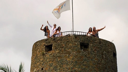 People on top of the stone tower at Blackbeard's Castle in St Thomas