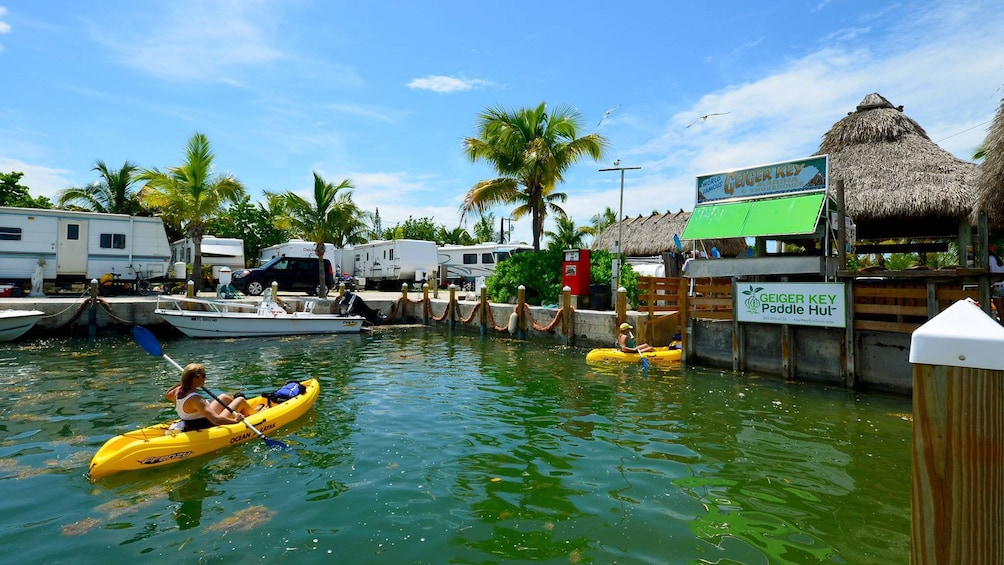 Show item 1 of 5. Kayakers paddle up to paddle hut in Florida Keys