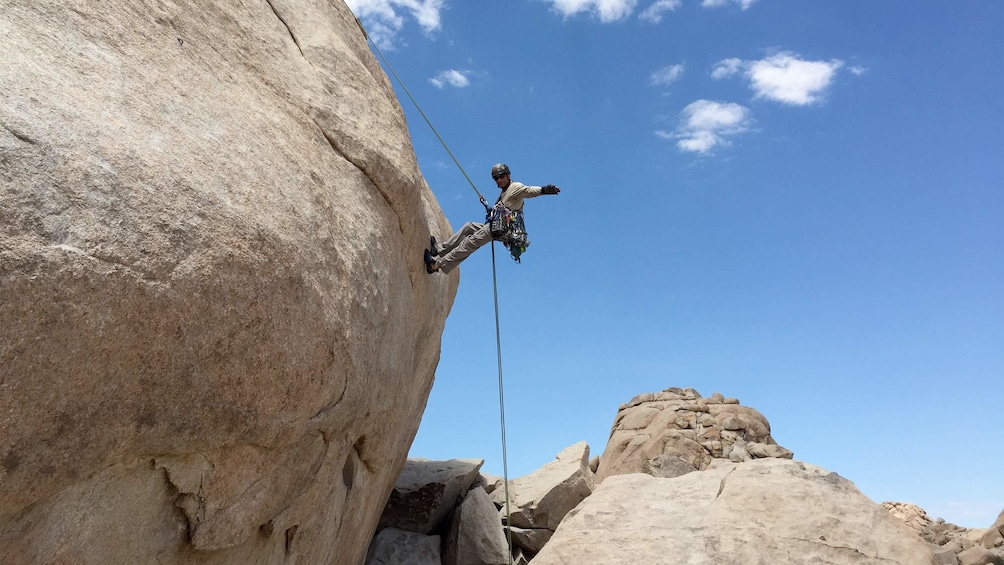 Show item 1 of 4. Man enjoying the scenic views on the Rappelling Adventure at Joshua Tree