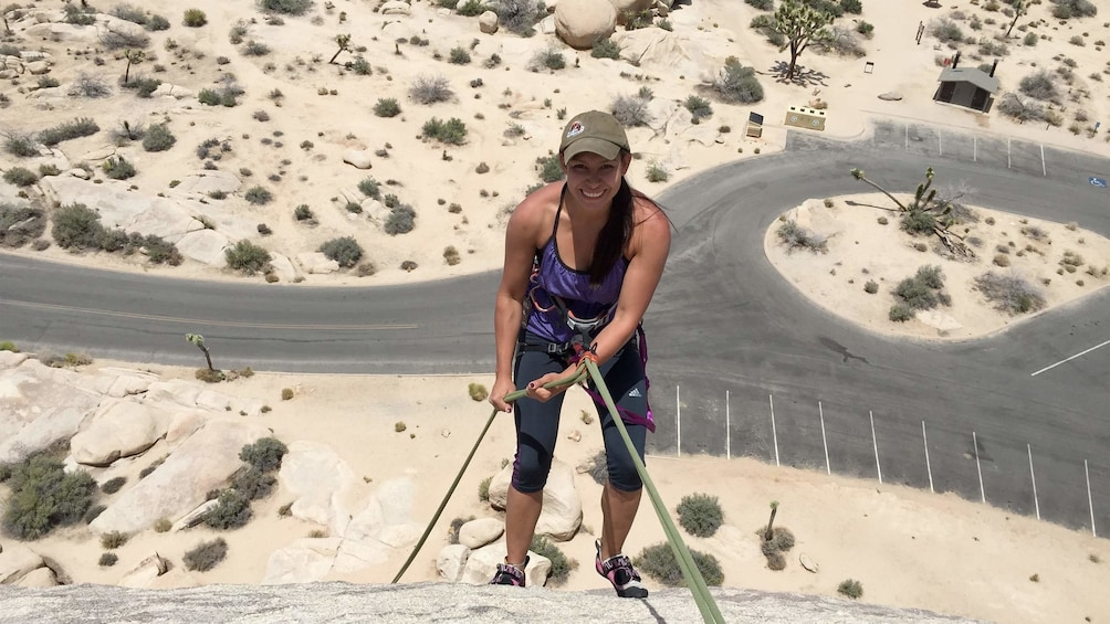 Show item 4 of 4. Woman on the Rappelling Adventure at Joshua Tree