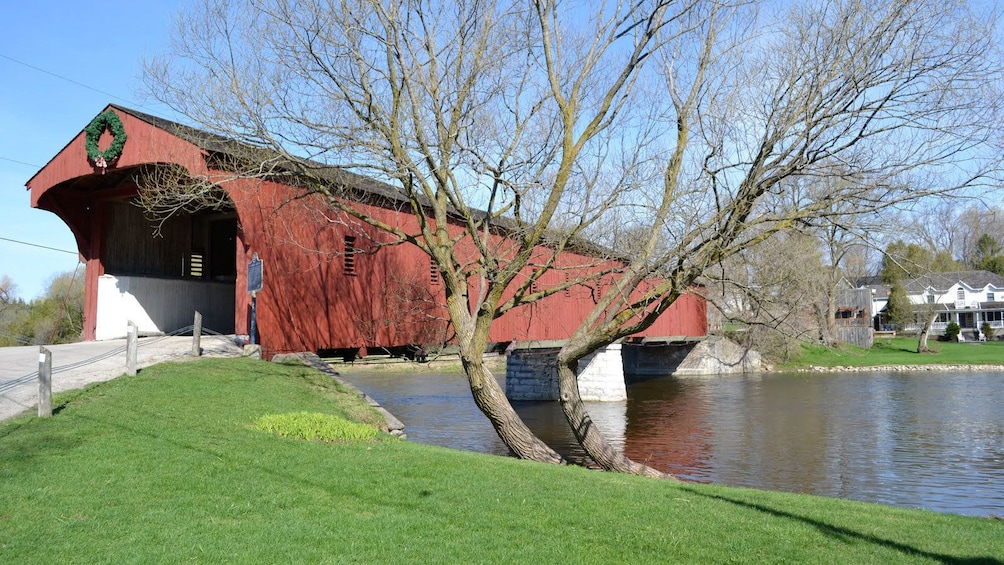 Show item 4 of 4. Covered bridge over a river in St Jacobs