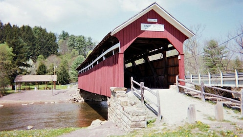 Covered bridge over a river in St Jacobs