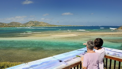 Two people on a deck looking at the water of St. Martin