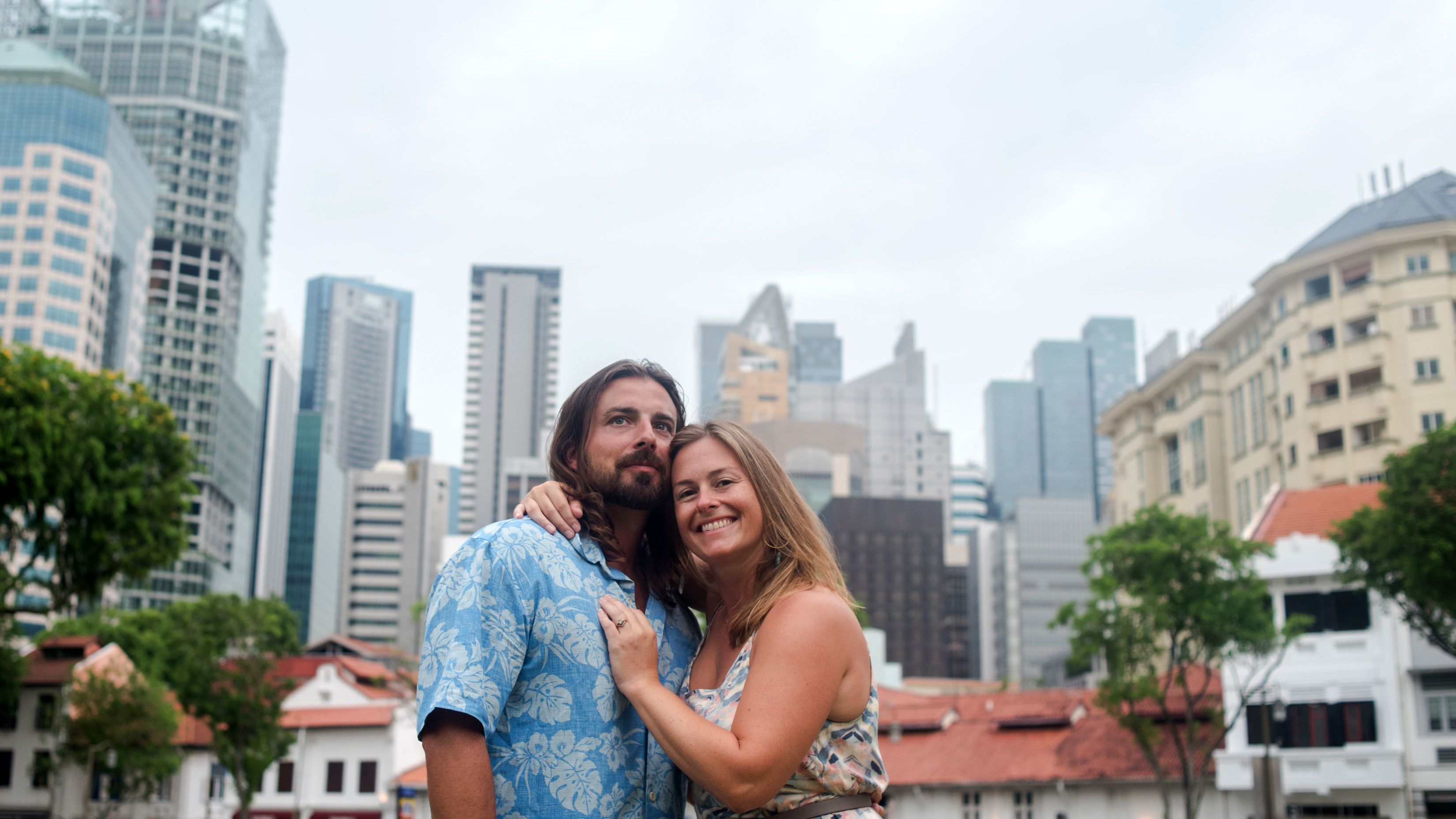 Couple posing with city in the background in Singapore