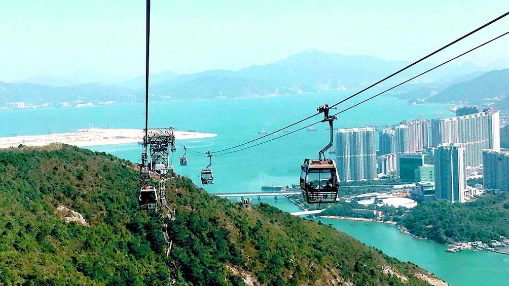 Show item 1 of 10. Cable gondolas over Hong Kong