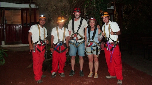 Ziplining group with head lamps at night in Costa Rica