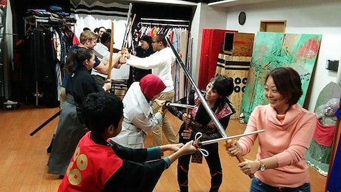 People practice sparring with swords in studio in Osaka