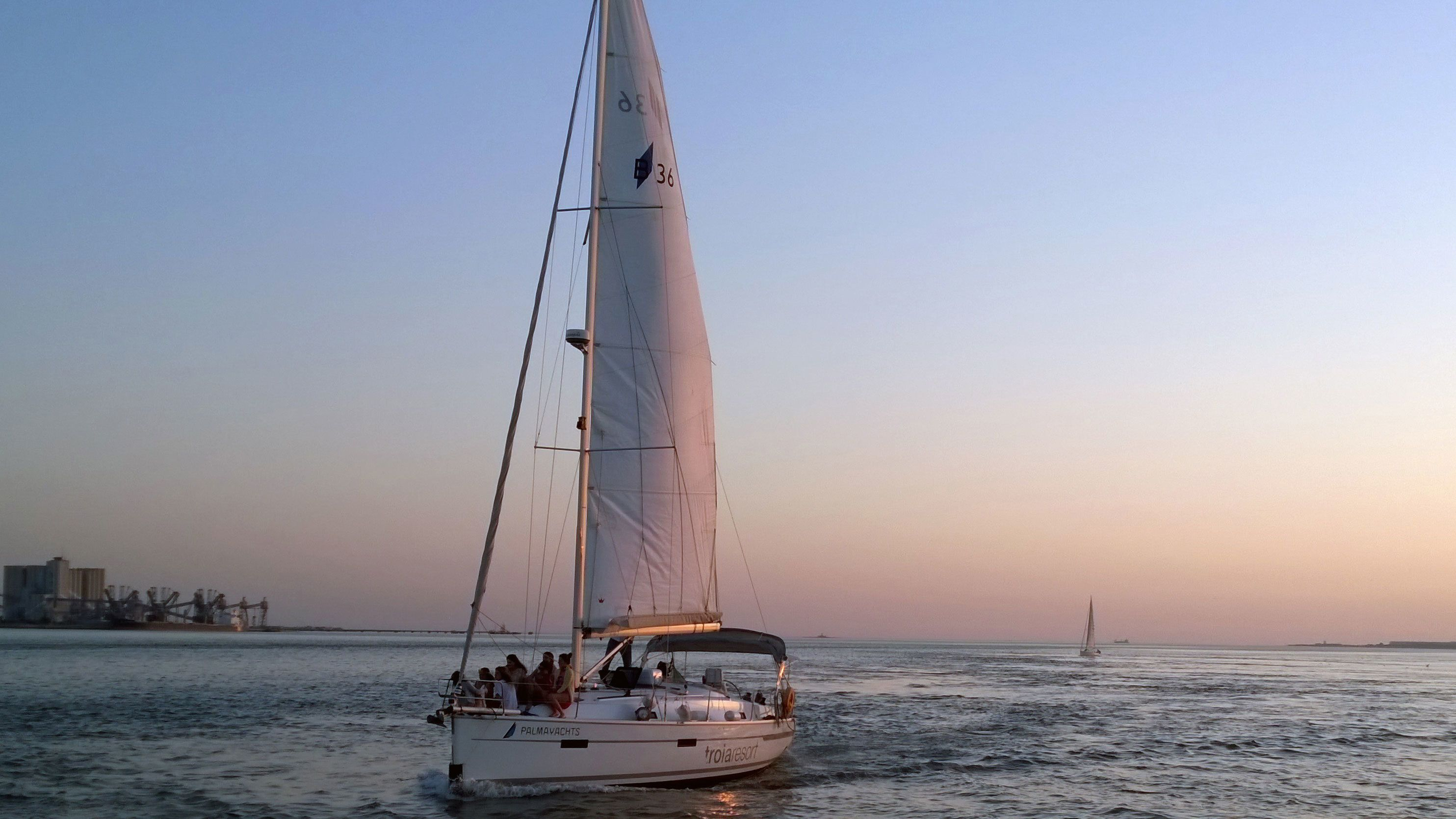 Sail boat tour at sunset in Lisbon