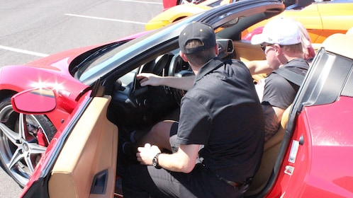 Two men in a parked muscle car