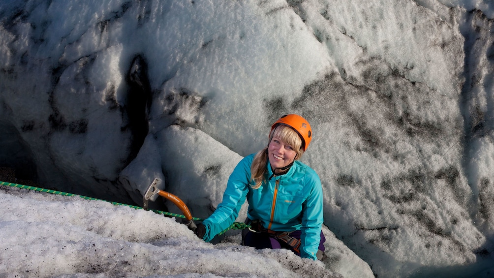 Woman climbing a glacier in iceland
