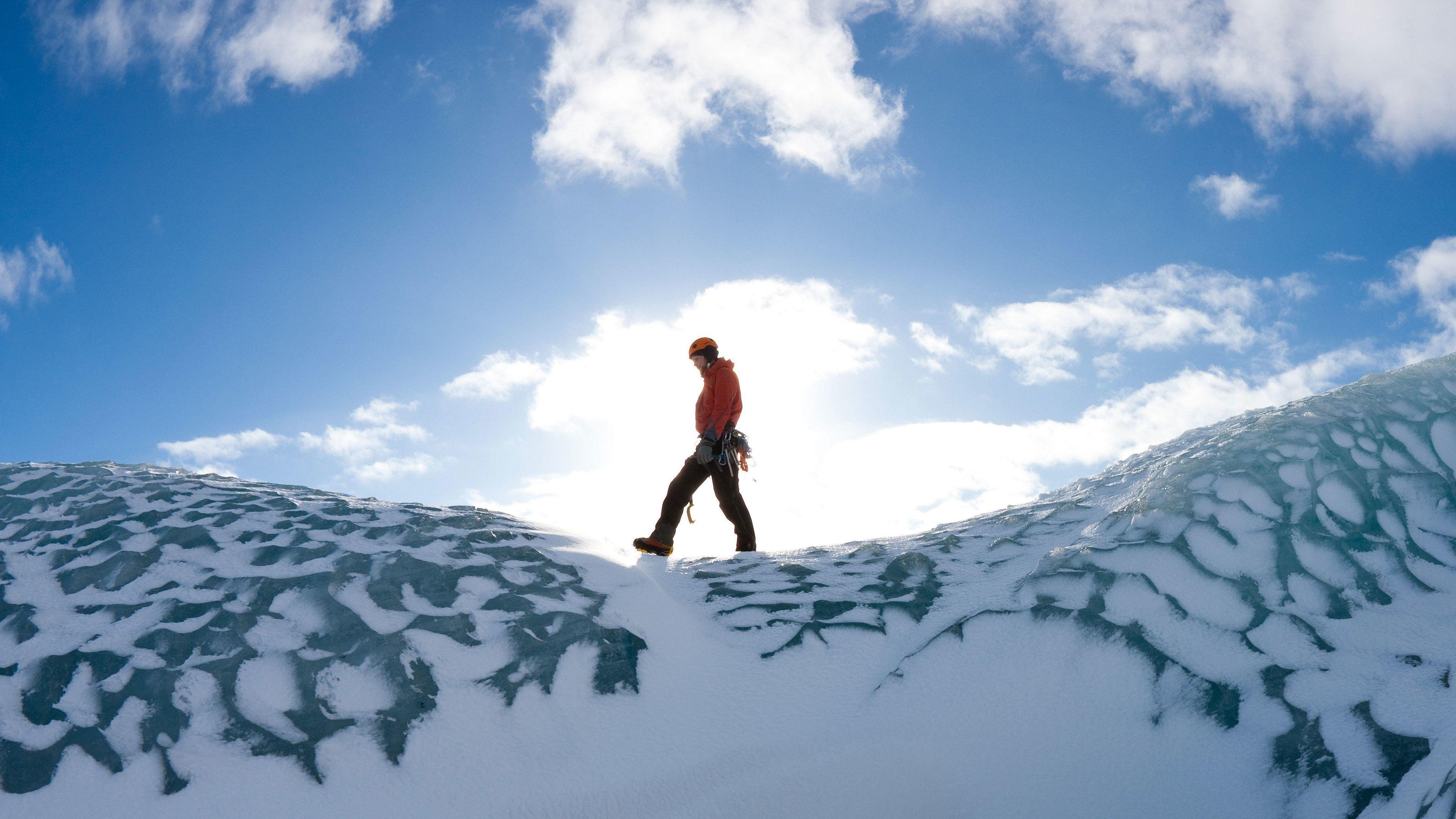 Person walking on a glacier