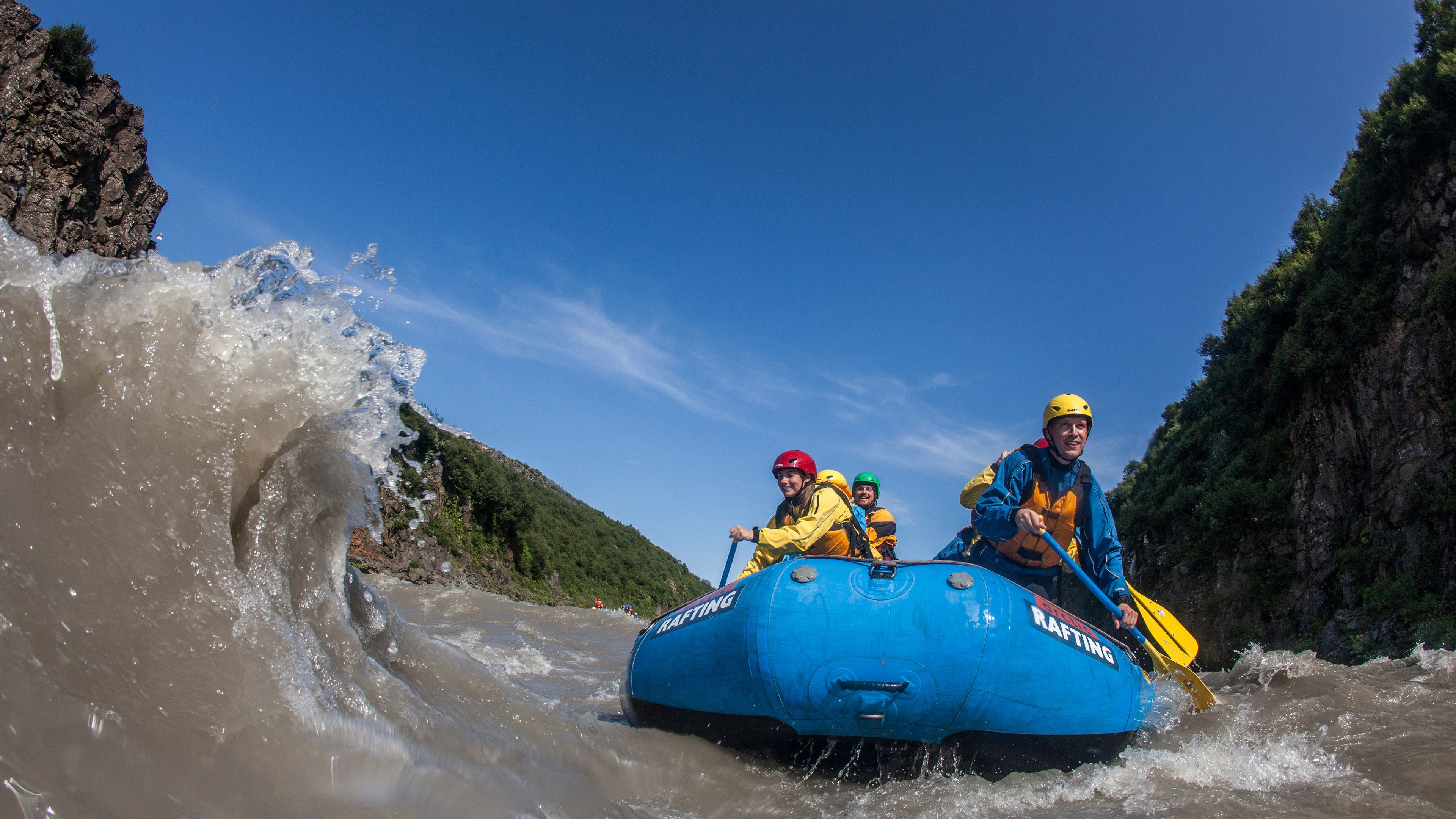 View of a group enjoying a water rafting adventure in Gullfoss Canyon of southwest Iceland