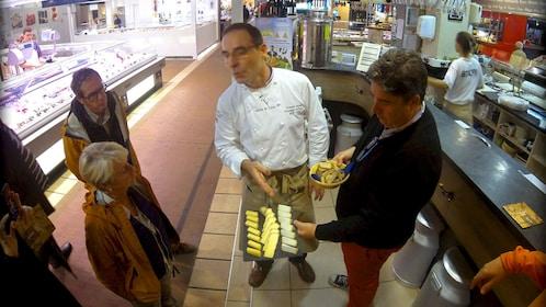 Cheese monger in Lyon market