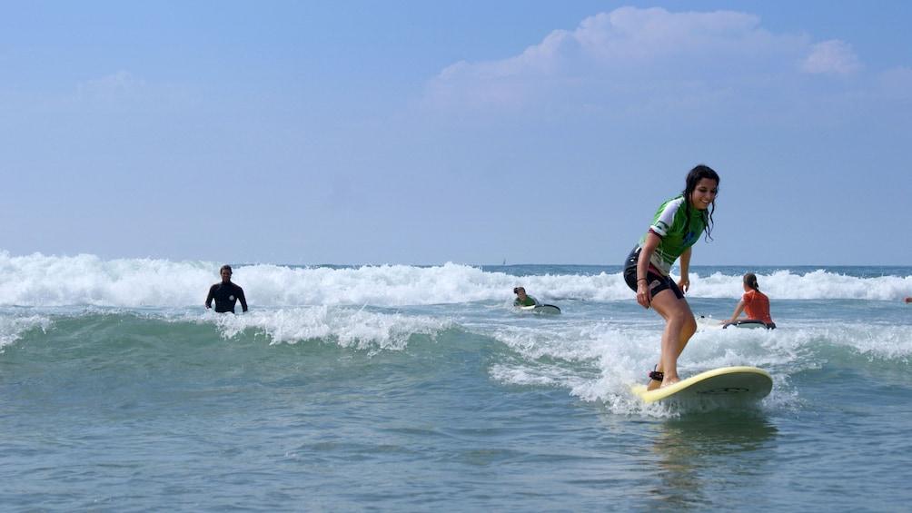 Charger l'élément 1 sur 5. Young woman surfing on the Basque Coast