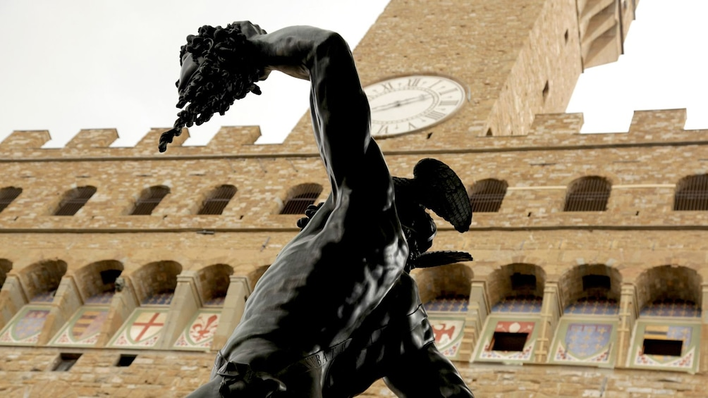 Show item 3 of 5. The Palazzo Vecchio with statue.