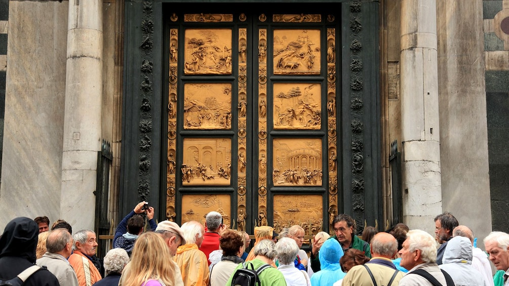 Show item 5 of 5. Tour in front of the Baptist Doors in Florence, Italy