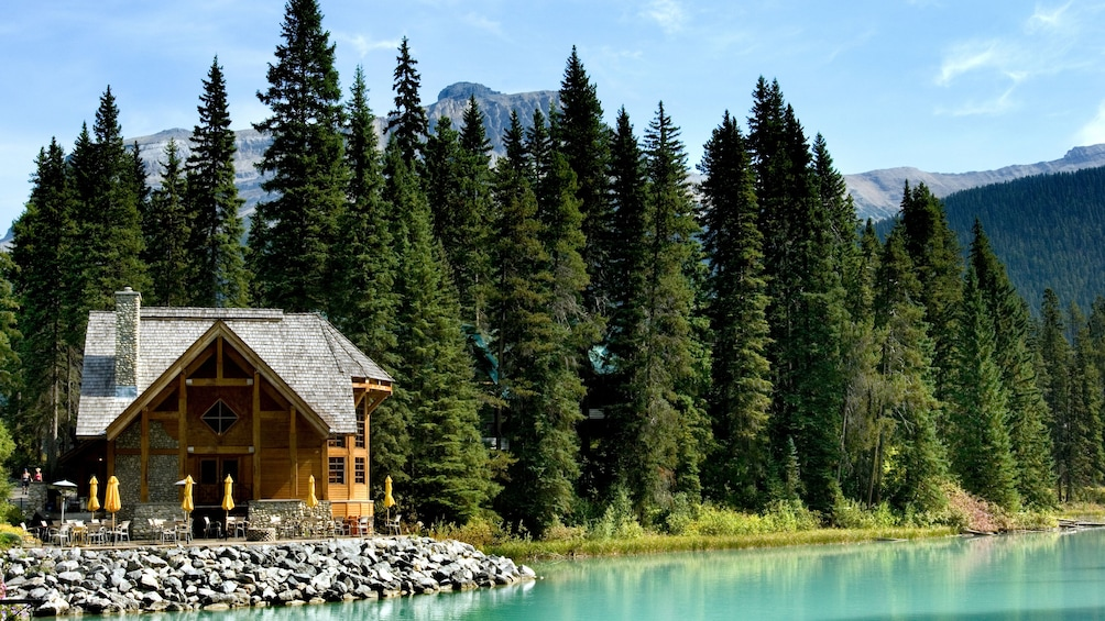 Show item 4 of 5. A cabin on a lake in Canada