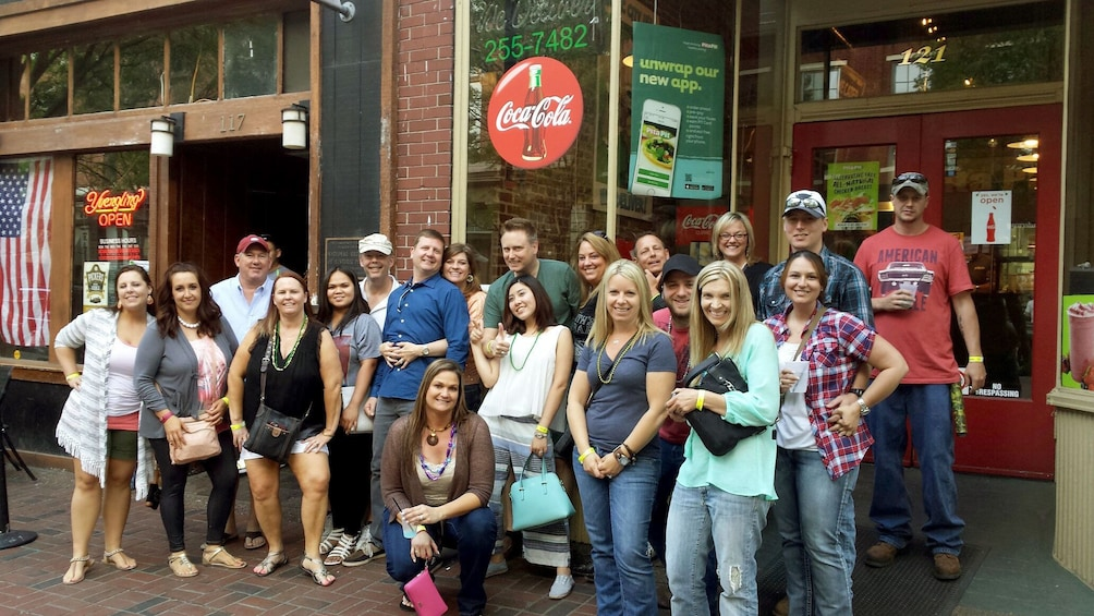 Show item 1 of 8. Large group outside a pub in Nashville