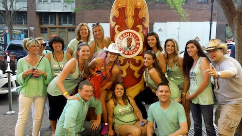 Group posing next to large cowboy boot outside a pub in Nashville