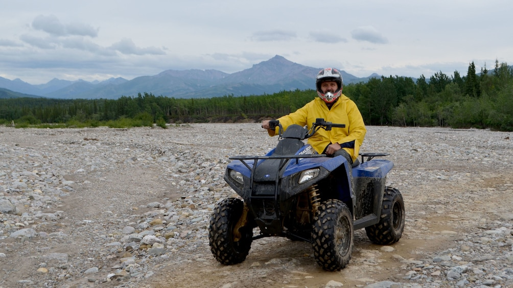 Show item 1 of 4. ATV rider with mountain in the background at Denali National Park
