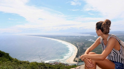 Woman looking out at the ocean from a cliff in Rio de Janeiro