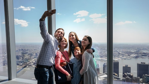 Family takes picture at One World Observatory in New York