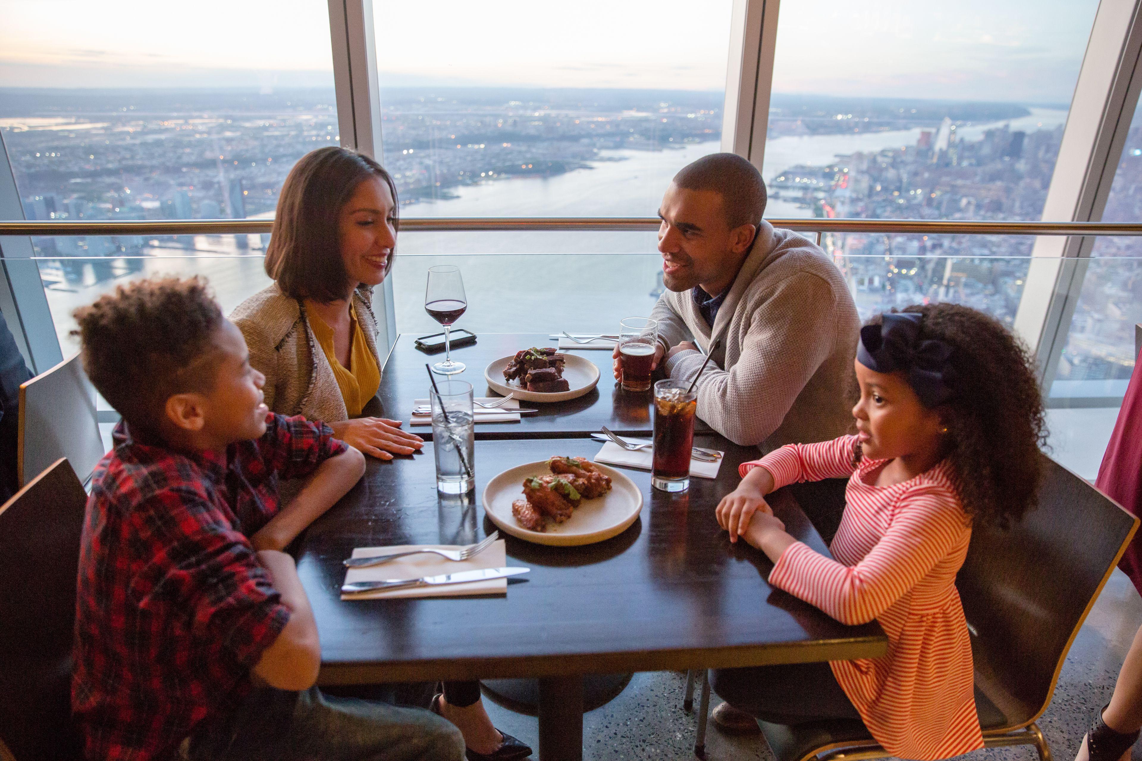 Family enjoying dinner at One World Observatory in New York