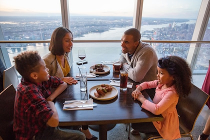 Family enjoying dinner at One World Observatory in New York